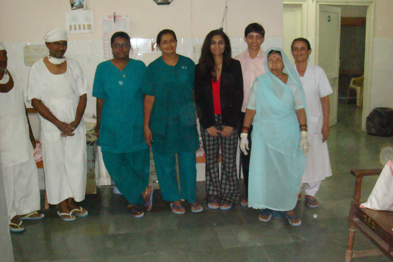 Dr. Gupta with the operating room staff that assisted with operating room clean-up and set-up